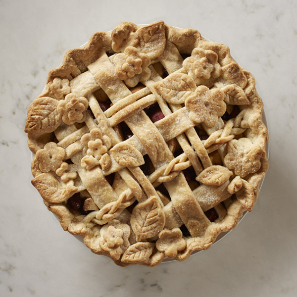 Cherry apple pie with a lovely floral and woven pie crust