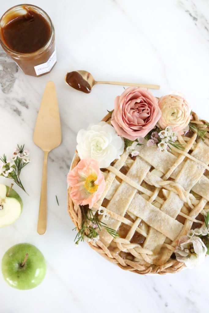 Stunning braided and woven pie crust, pie decorated with fresh flowers