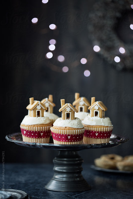 Cupcakes topped with tiny gingerbread houses