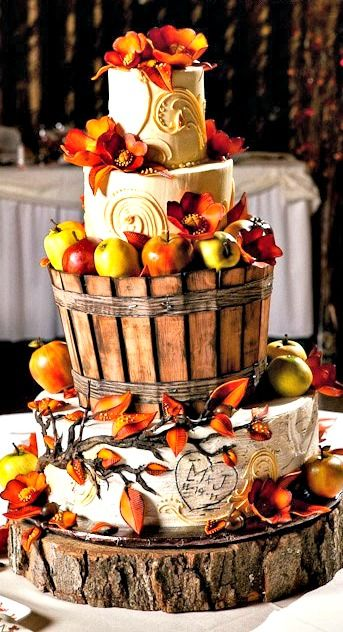 Gorgeous fall wedding cake carved to look like a basket of apples