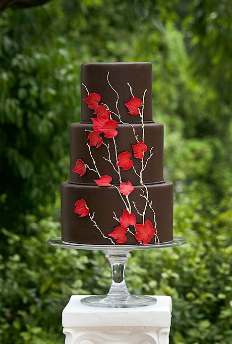 Dark brown chocolate tiered fall wedding cake with red fall maple leaves