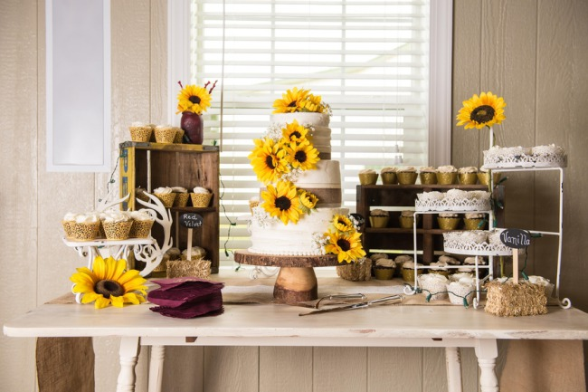 Rustic fall wedding cake with sunflowers and burlap