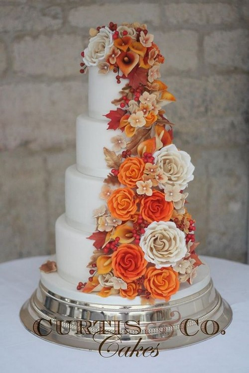 Fall wedding cake with handcrafted sugar paste flowers in rich oranges and golds