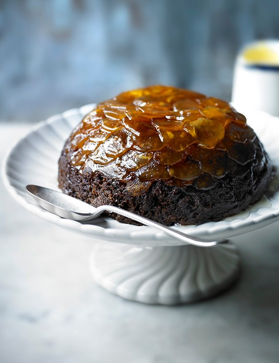 gingerbread Christmas pudding with eggnog sauce.