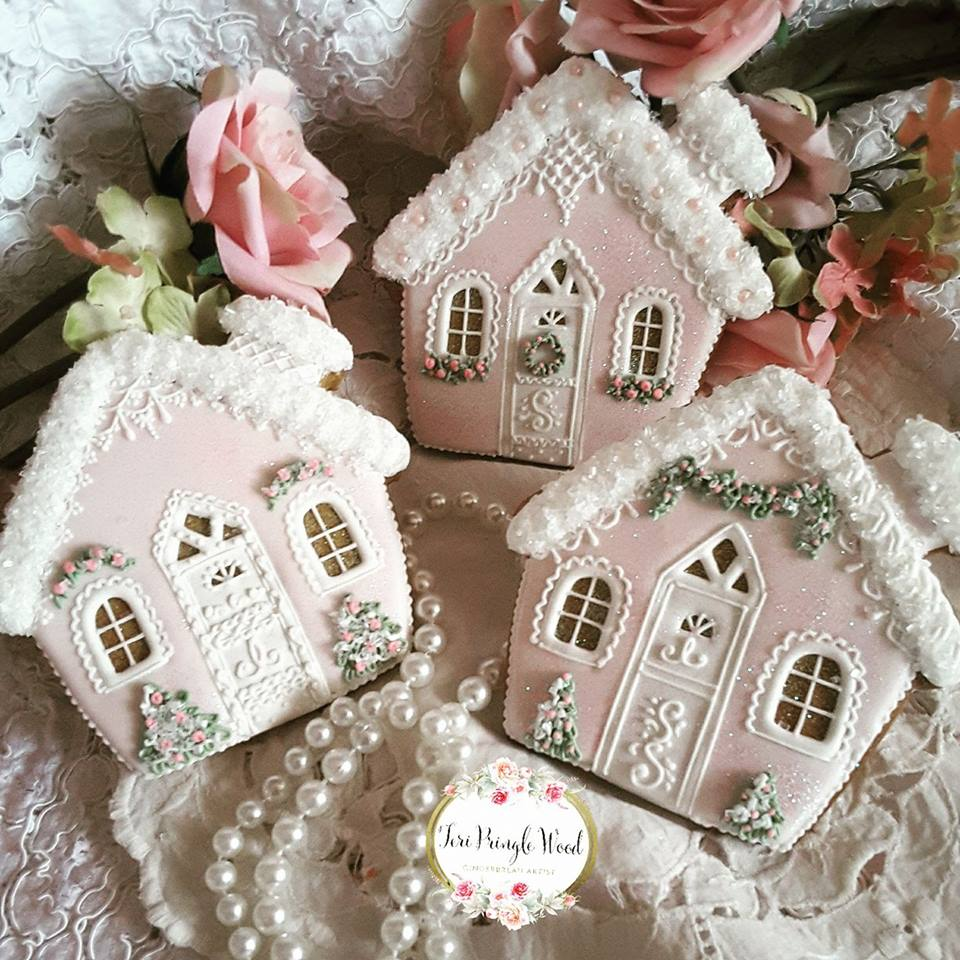 Pastel Christmas gingerbread house cookies, winter village, decorated with royal icing.