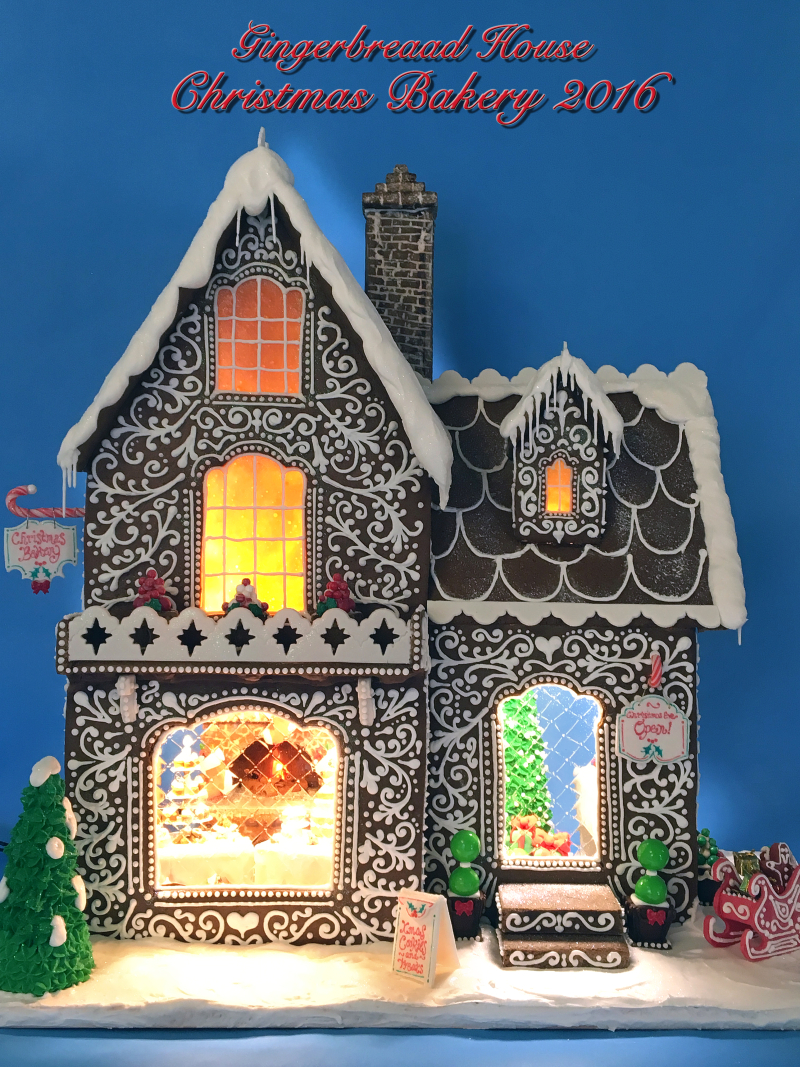 intricate gingerbread house, lit up, with a working chimney
