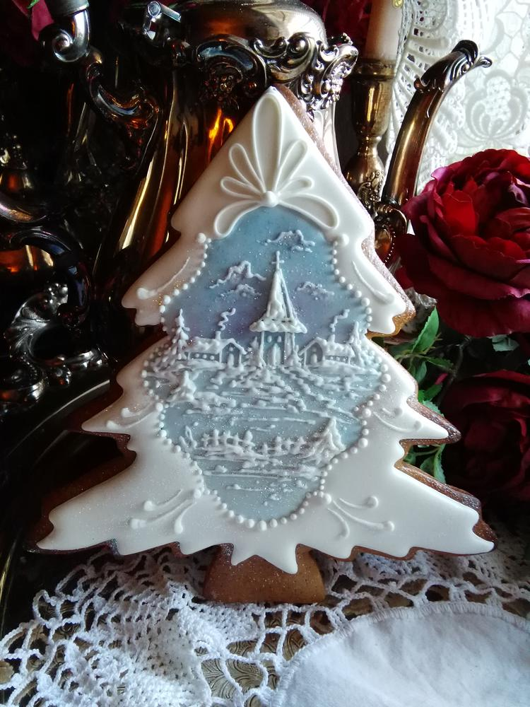 Stunning Christmas sugar cookie with a royal icing village scene
