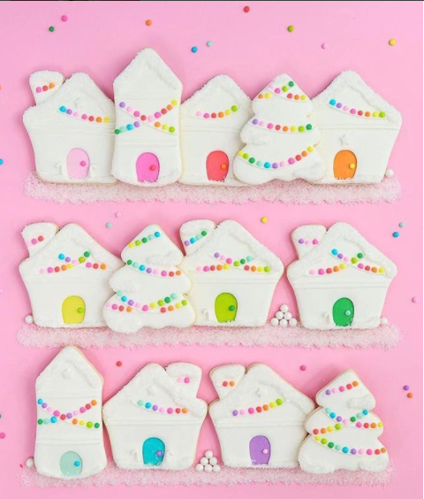 Bright pastel Christmas village sugar cookies, decorated with royal icing.