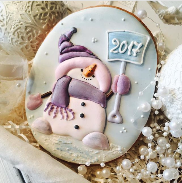 Adorable snowman pastel Christmas or winter sugar cookie