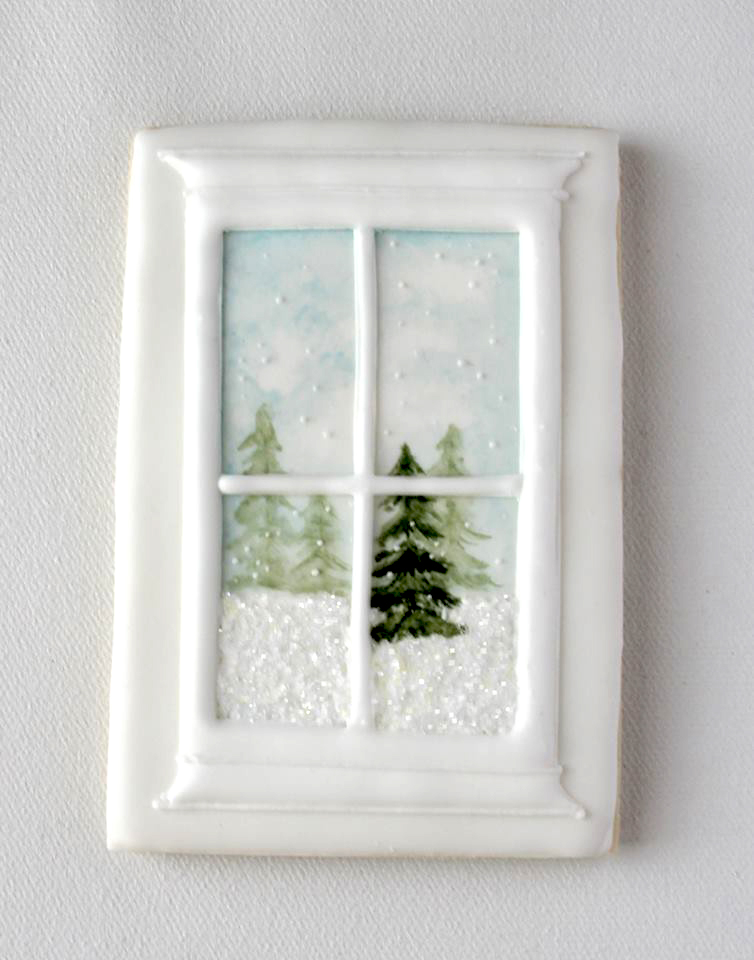 Winter window with a snowy scene outside--in sugar cookie form