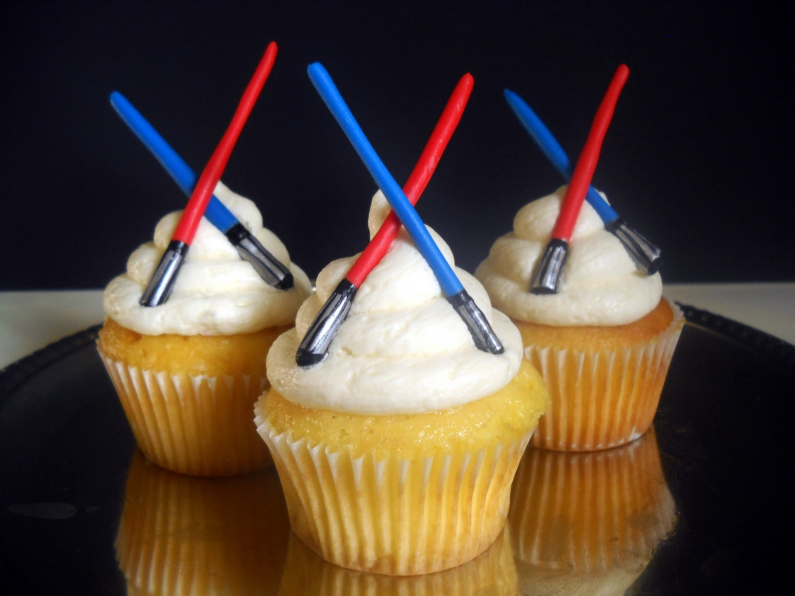 Fondant or gum paste Star Wars lightsabers make perfect cupcake toppers
