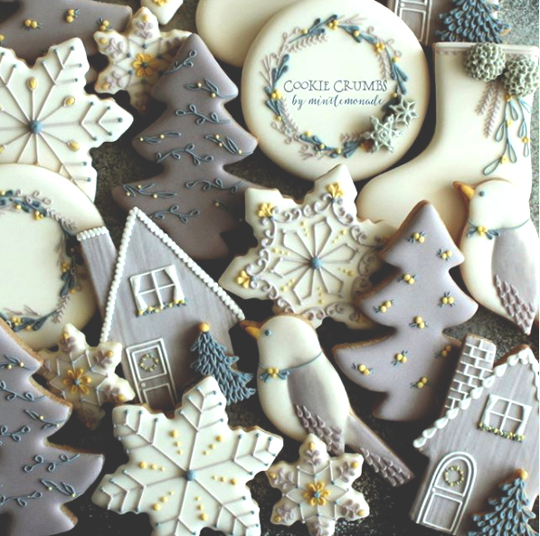 Stunning grey and yellow winter sugar cookies decorated with royal icing.