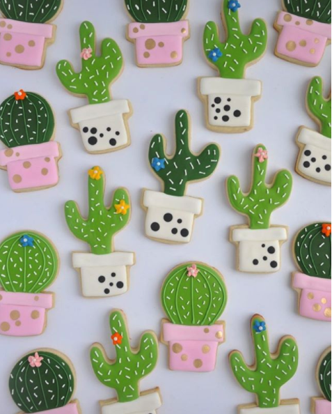 kitchy and cute cactus cookies decorated with royal icing