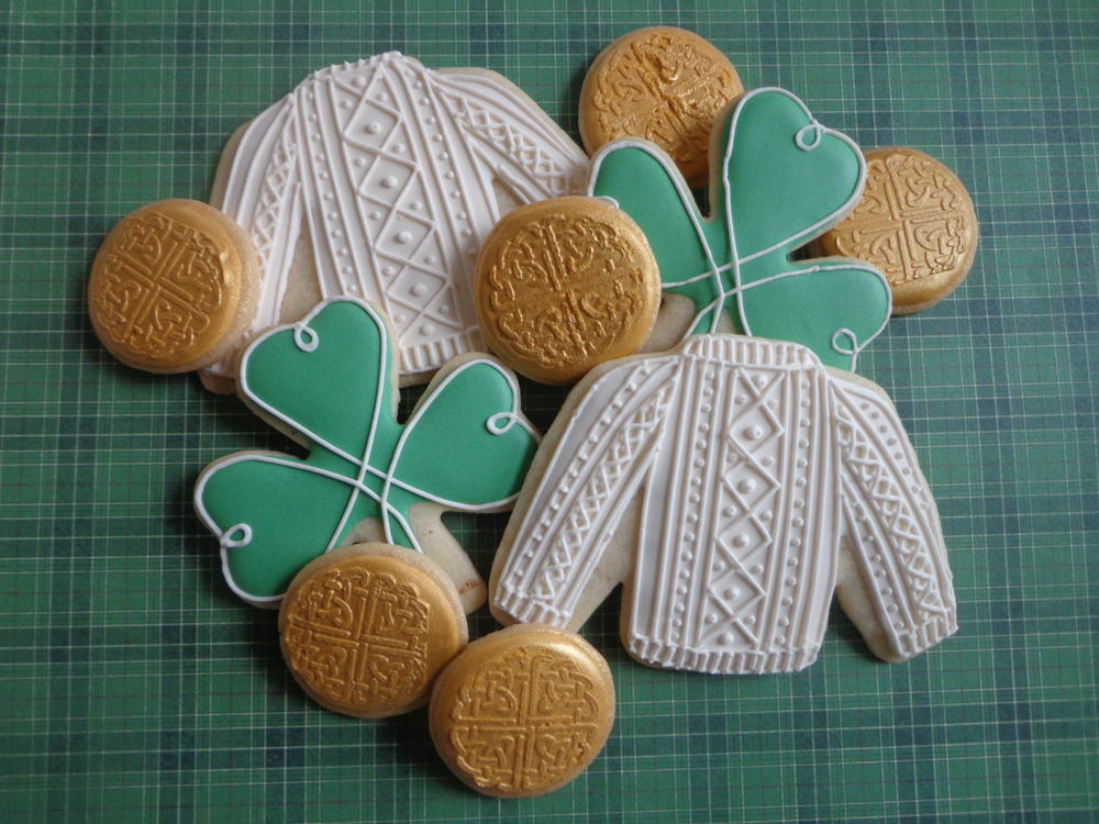 Irish sweaters, gold, and shamrocks cookies for St. Patrick's Day