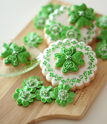 stunning St. Patrick's day sugar cookies decorated with royal icing shamrocks