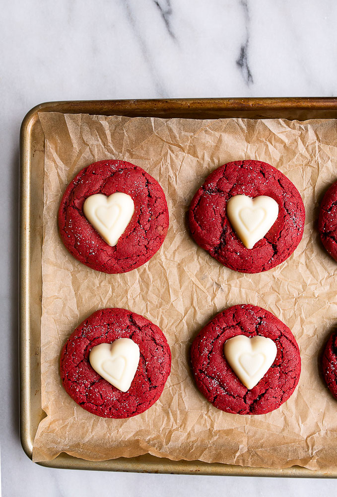 Red velvet sugar cookies with white chocolate hearts